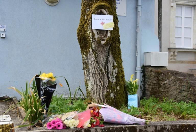 Flowers laid at the spot where a policewoman was stabbed in La Chapelle-sur-Erdre near the western city of Nantes on Friday