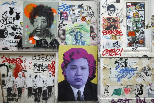 Political street art depicting musician Jimi Hendrix (top L) and North Korean leader Kim Jong-un (bottom C) are seen near Brick Lane in east London January 14, 2015. REUTERS/Luke MacGregor (BRITAIN - Tags: POLITICS SOCIETY ENTERTAINMENT)