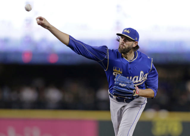 FILE - In this June 30, 2018, file photo, Kansas City Royals starting pitcher Jason Hammel works against the Seattle Mariners during the first inning of a baseball game in Seattle. Free agent right-hander Hammel has agreed to a minor league deal with the Texas Rangers and will report to major league spring training. (AP Photo/John Froschauer, File)