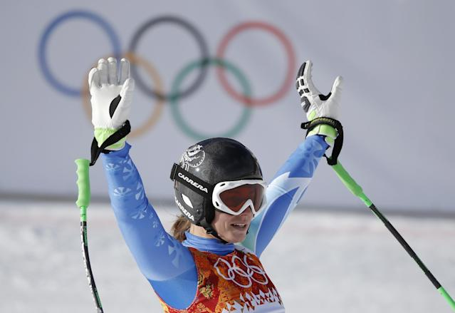 Slovenia's Tina Maze waves from the finish area after finishing the downhill portion of the women's supercombined at the Sochi 2014 Winter Olympics, Monday, Feb. 10, 2014, in Krasnaya Polyana, Russia. (AP Photo/Christophe Ena)