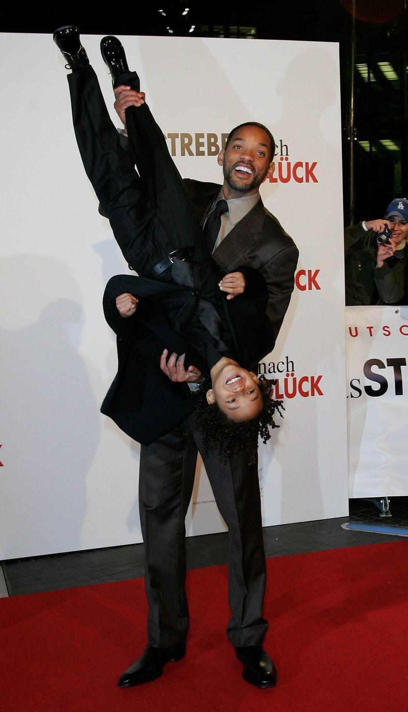 <p>Will Smith holds his son Jaden Smith upside down during the German premiere of <em>The Pursuit of Happyness</em> on January 9, 2007 in Berlin, Germany.</p>