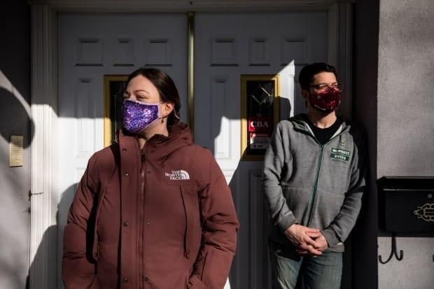 Steve and Melanie Whitlow say a missing number in paperwork submitted to Immigration, Refugees and Citizenship Canada resulted in their work permit extension being refused. (Ben Nelms/CBC - image credit)