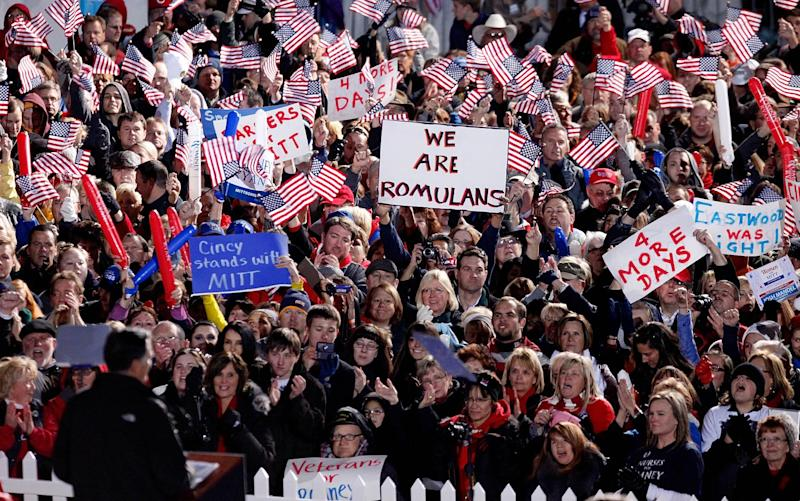 Supporters cheer, wave American flags and signs as Republican presidential candidate, former Massachusetts Gov. Mitt Romney, lower left, speaks during a campaign event at The Square at Union Centre, Friday, Nov. 2, 2012, in West Chester, Ohio. (AP Photo/David Goldman)