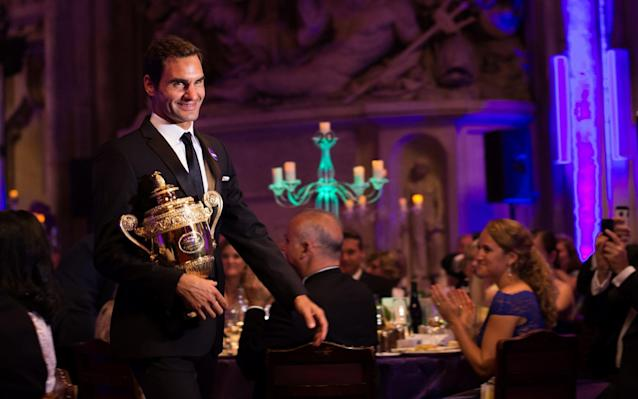 <span>Federer attended the traditional champions' dinner</span> <span>Credit: GETTY IMAGES </span>