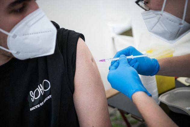A man is vaccinated against the COVID-19 coronavirus at a drive thru vaccination center outside an IKEA store in Berlin , on July 29, 2021, amid the novel coronavirus / COVID-19 pandemic. (Photo by STEFANIE LOOS / AFP) (Photo by STEFANIE LOOS/AFP via Getty Images) (Photo: STEFANIE LOOS via Getty Images)
