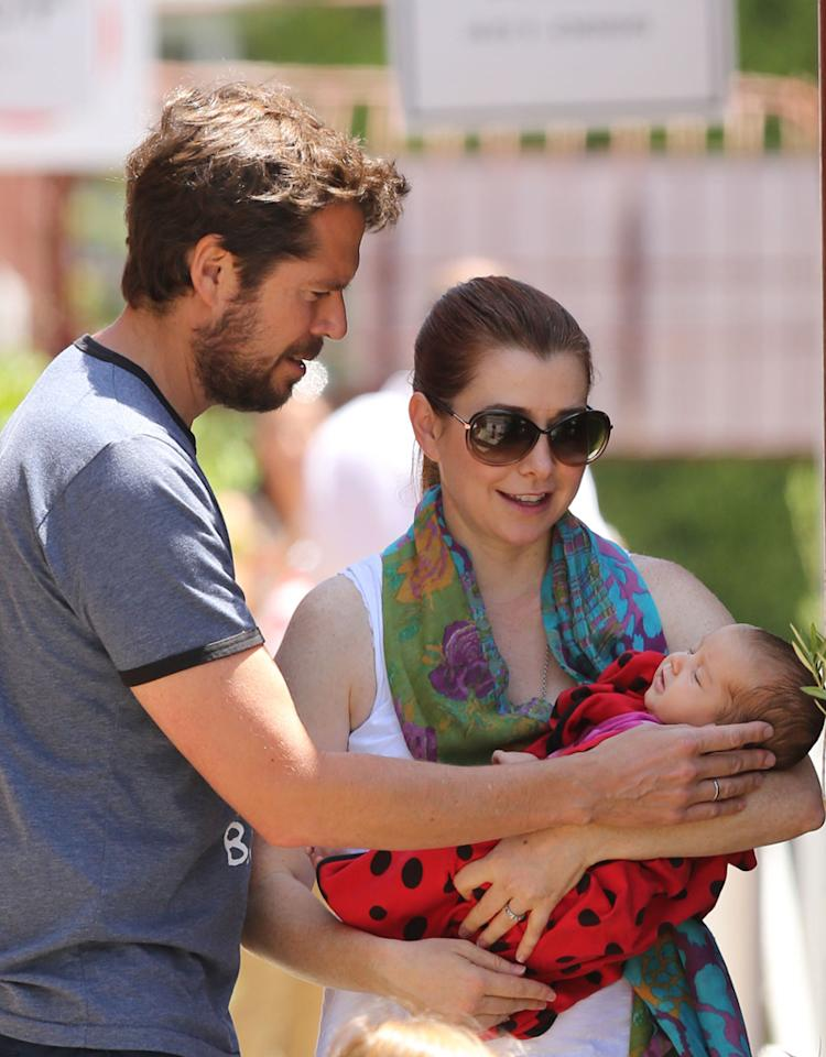 Alyson Hannigan carries baby Keeva on a family day out in LA. The 'How I met Your Mother' star was seen lunching with husband, Alexis and daughter, Satyana at Brentwood Country Mart. Alyson showed off her new bundle of joy as she carried her new baby in the LA sun. Pictured: Alyson Hannigan, Alexis Denisof and daughters, Keeva and Satyana  Ref: SPL417193  150712  Picture by: Splash News   Splash News and Pictures Los Angeles:310-821-2666 New York:212-619-2666 London:870-934-2666 photodesk@splashnews.com