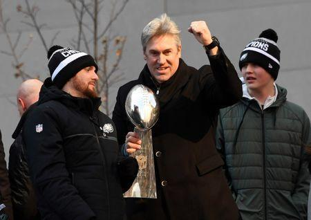 Feb 8, 2018; Philadelphia, PA, USA; Philadelphia Eagles head coach Doug Pederson holds the Lombardi trophy during Super Bowl LII champions parade. Mandatory Credit: Kirby Lee-USA TODAY Sports