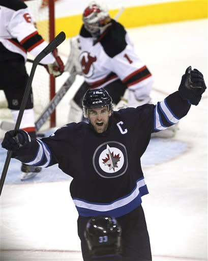 Winnipeg Jets' Andrew Ladd (16) celebrates his goal against the New Jersey Devils during the third period of an NHL hockey game in Winnipeg, Manitoba, on Thursday, Feb. 28, 2013. (AP Photo/The Canadian Press, John Woods)