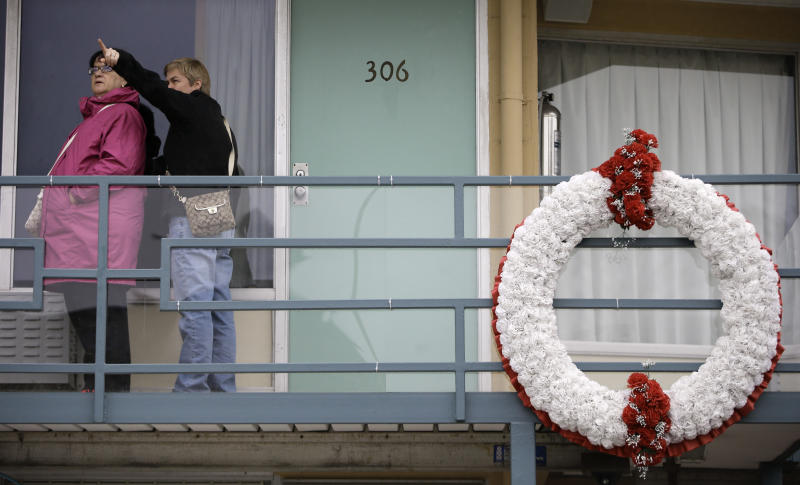 FILE - This April 3, 2013 file photo shows Selma Rudderham, left, and Tammy Whithard, of Cape Breton, Nova Scotia, right, pointing to where the shot came from that killed Dr. Martin Luther King as she tours the balcony of the former Lorraine Motel, now a part of the National Civil Rights Museum, in Memphis, Tenn. The spot outside room 306 is where Dr. Martin Luther King was assassinated on April 4, 1968, while in Memphis to support striking sanitation workers. The museum, which first opened in 1991, is now ready to show off new, emotionally-moving exhibits and flashy, informative interactive displays. The museum says it attracts 200,000 people every year, but the renovations are impressive enough that they could lead to a spike in visitor turnout. (AP Photo/Mark Humphrey, File)