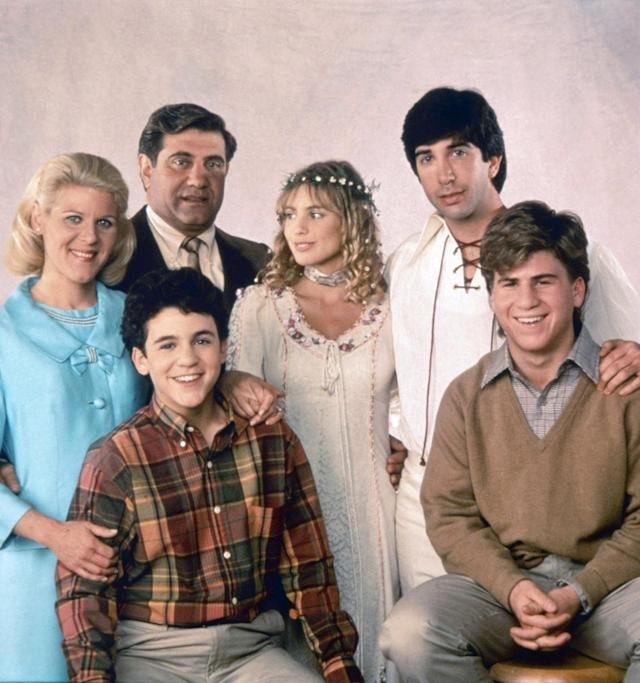 Karen Arnold (Olivia d'Abo) married her boyfriend Michael (David Schwimmer) in a fittingly hippie-themed ceremony in Season 5 of <em>The Wonder Years.</em> (Photo: Everett Collection)