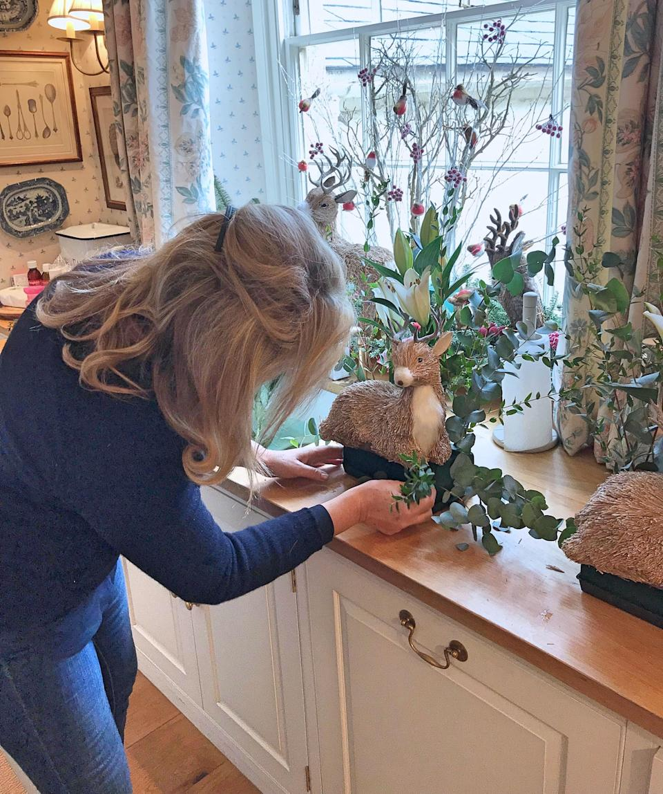 My mother is a genius when it comes to the tricky part of assembling all these woodland creatures into an oasis. Here she is putting the finishing touches to this sweet little deer.