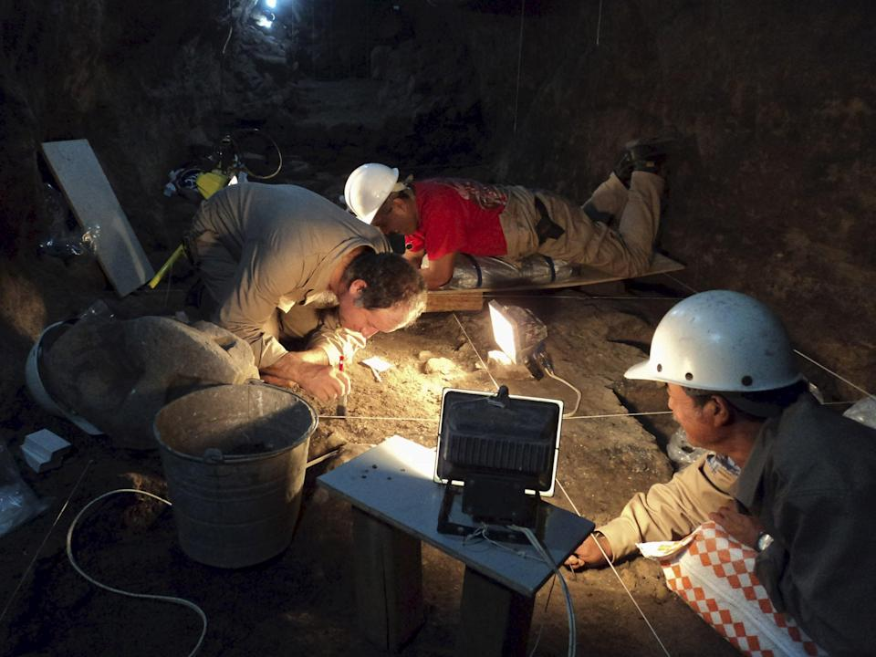 """National Institute of Anthropology and History (INAH) archaeologists work at a tunnel that may lead to a royal tombs discovered at the ancient city of Teotihuacan, in this May 9, 2011 INAH handout file picture made available to Reuters October 29, 2014. A Mexican archeologist hunting for a royal tomb in a deep, dark tunnel beneath a towering pre-Aztec pyramid has made a discovery that may have brought him a step closer: liquid mercury. In the bowels of Teotihuacan, a mysterious ancient city that was once the biggest in the Americas, Sergio Gomez this month found """"large quantities"""" of the silvery metal in a chamber at the end of a sacred tunnel sealed for nearly 1,800 years. Gomez says the excavation of the chambers should finish by October with a public announcement by the end of 2015. REUTER/INAH/Files/Handout via Reuters ATTENTION EDITORS - THIS PICTURE WAS PROVIDED BY A THIRD PARTY. REUTERS IS UNABLE TO INDEPENDENTLY VERIFY THE AUTHENTICITY, CONTENT, LOCATION OR DATE OF THIS IMAGE. FOR EDITORIAL USE ONLY. NOT FOR SALE FOR MARKETING OR ADVERTISING CAMPAIGNS."""