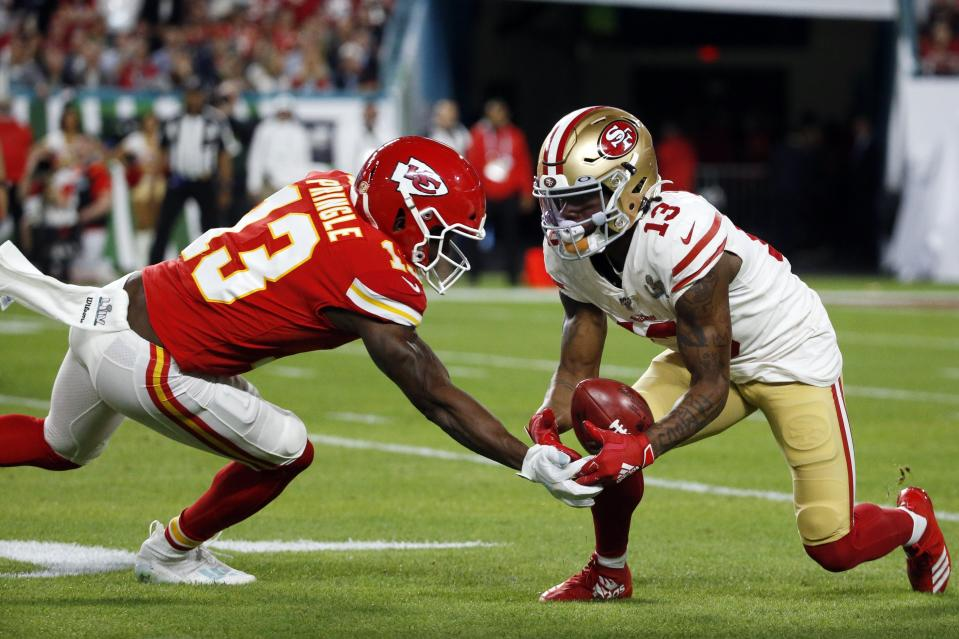 San Francisco 49ers' Richie James Jr. (13) recovers the ball in front of Kansas City Chiefs' Byron Pringle (13) during the first half of the NFL Super Bowl 54 football game Sunday, Feb. 2, 2020, in Miami Gardens, Fla. (AP Photo/Mark Humphrey)