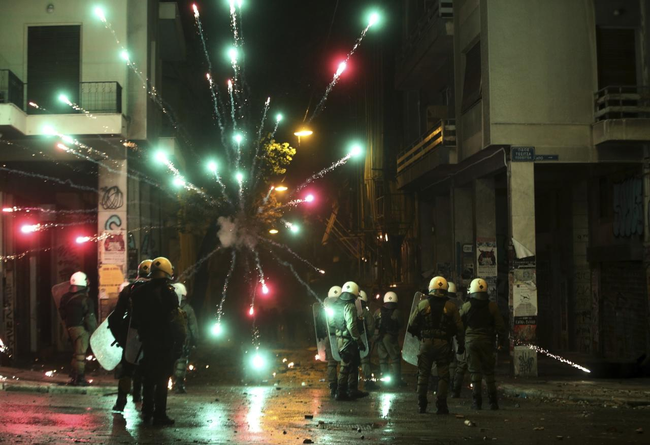 <p>Hooded youths throw petrol bombs at riot police in the Athens neighborhood of Exarchia, a haven for extreme leftists and anarchists, Thursday, Dec. 6, 2018 after a rally commemorating the killing of a 15-year old student back in 2008. Demonstrators in Greece threw firebombs and pelted police with rocks Thursday as marches on the 10th anniversary of the fatal police shooting of a teenager degenerated into violence. (AP Photo/Yorgos Karahalis) </p>