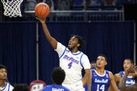 DePaul guard Javon Freeman-Liberty drives to the basket during the second half of an NCAA college basketball game against Seton Hall in Chicago, Saturday, Jan. 9, 2021. (AP Photo/Nam Y. Huh)