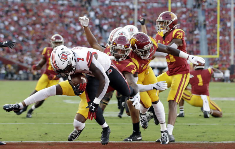 Utah running back Devonta'e Henry-Cole (7) runs in for a touchdown against Southern California during the first half of an NCAA college football game Friday, Sept. 20, 2019, in Los Angeles. (AP Photo/Marcio Jose Sanchez)