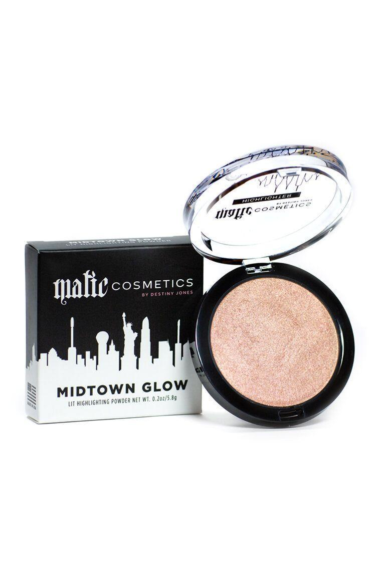 "<p><strong>Matic Cosmetics</strong></p><p>lipmatic.com</p><p><strong>$30.00</strong></p><p><a href=""https://www.lipmatic.com/shop-all/midtown-glow"" rel=""nofollow noopener"" target=""_blank"" data-ylk=""slk:Shop Now"" class=""link rapid-noclick-resp"">Shop Now</a></p><p>Lipmatic features an organic formula within its stunning lip gloss shades. The highly pigmented colors make them a great choice for richer skin tones.</p>"