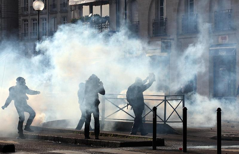 Demonstrators clash with French riot police during a demonstration in Nantes, Saturday Feb. 22, 2014, as part of a protest against a project to build an international airport, in Notre Dame des Landes, near Nantes. The project was decided in 2010 and the international airport should open by 2017. (AP Photo / Laetitia Notarianni)
