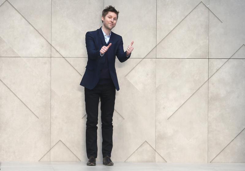 Chief Creative Officer of Burberry Christopher Bailey walks on the catwalk following the presentation of the Burberry Prorsum Autumn/Winter 2013 collection during London Fashion Week