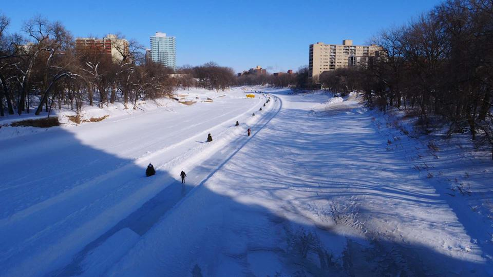 Skaters use the Red River Mutual Trail in Winnipeg, Canada. (STR/AFP via Getty Images)