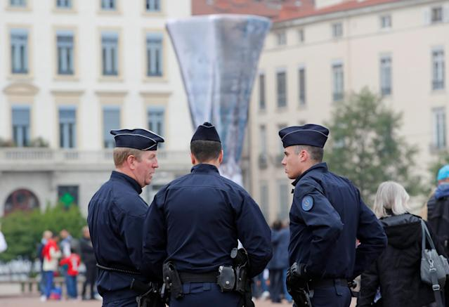 Soccer Football - Europa League Final - Olympique de Marseille vs Atletico Madrid - Lyon, France - May 16, 2018 Police officers in the town centre before the match REUTERS/Denis Balibouse