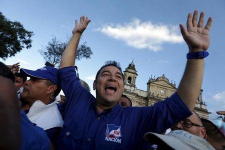 File photo of Guatemalan presidential candidate Jimmy Morales saluting before a political rally in downtown Guatemala City