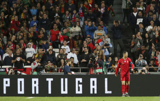 Portugal's Cristiano Ronaldo walks during the Euro 2020 group B qualifying soccer match between Portugal and Ukraine at the Luz stadium in Lisbon, Friday, March 22, 2019. (AP Photo/Armando Franca)