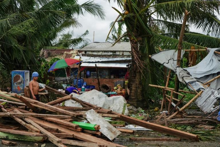 Typhoon Phanfone swept across the central Philippines on Christmas Day, tearing roofs off houses