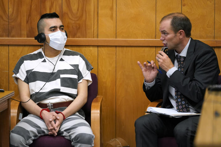Cristhian Bahena Rivera, left, listens to proceedings through an interpreter during his sentencing, Monday, Aug. 30, 2021, at the Poweshiek County Courthouse in Montezuma, Iowa. Rivera was sentenced to life in prison for the stabbing death of college student Mollie Tibbetts, who was abducted as she was out for a run near her small eastern Iowa hometown in July of 2018. (AP Photo/Charlie Neibergall, pool)