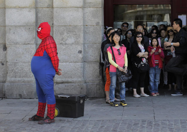 <p>A man dressed as Spider-Man performs for money as tourists look at the main square in Madrid, May 23, 2013. (AP Photo/Andres Kudacki) </p>