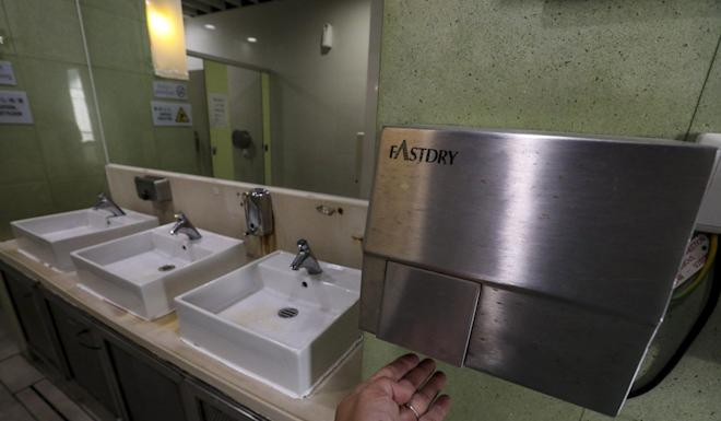 Warm air hand dryers came third in total bacterial counts. Photo: Felix Wong