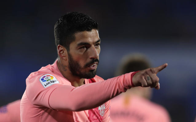 FC Barcelona's Luis Suarez celebrates after scoring during a Spanish La Liga soccer match between Getafe and FC Barcelona at the Alfonso Perez stadium in Getafe, Spain, Sunday, Jan. 6, 2019. (AP Photo/Manu Fernandez)