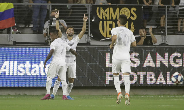 Los Angeles FC's Diego Rossi, center, celebrates his goal with teammate Latif Blessing (7) during the first half of the team's MLS soccer match against the San Jose Earthquakes on Wednesday, Aug. 21, 2019, in Los Angeles. (AP Photo/Marcio Jose Sanchez)