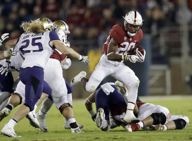 "Stanford 's <a class=""link rapid-noclick-resp"" href=""/ncaaf/players/257525/"" data-ylk=""slk:Bryce Love"">Bryce Love</a> (20) runs against Washington during the first half of an NCAA college football game Friday, Nov. 10, 2017, in Stanford, Calif. (AP Photo/Marcio Jose Sanchez)"