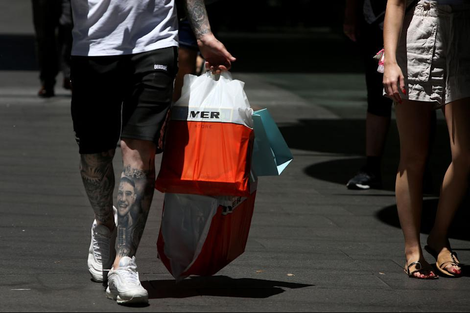 A shopper carries a Myer branded bag at Pitt Street Mall in Sydney, Australia, on December 7, 2020. Source: Lisa Maree Williams/Bloomberg via Getty Images