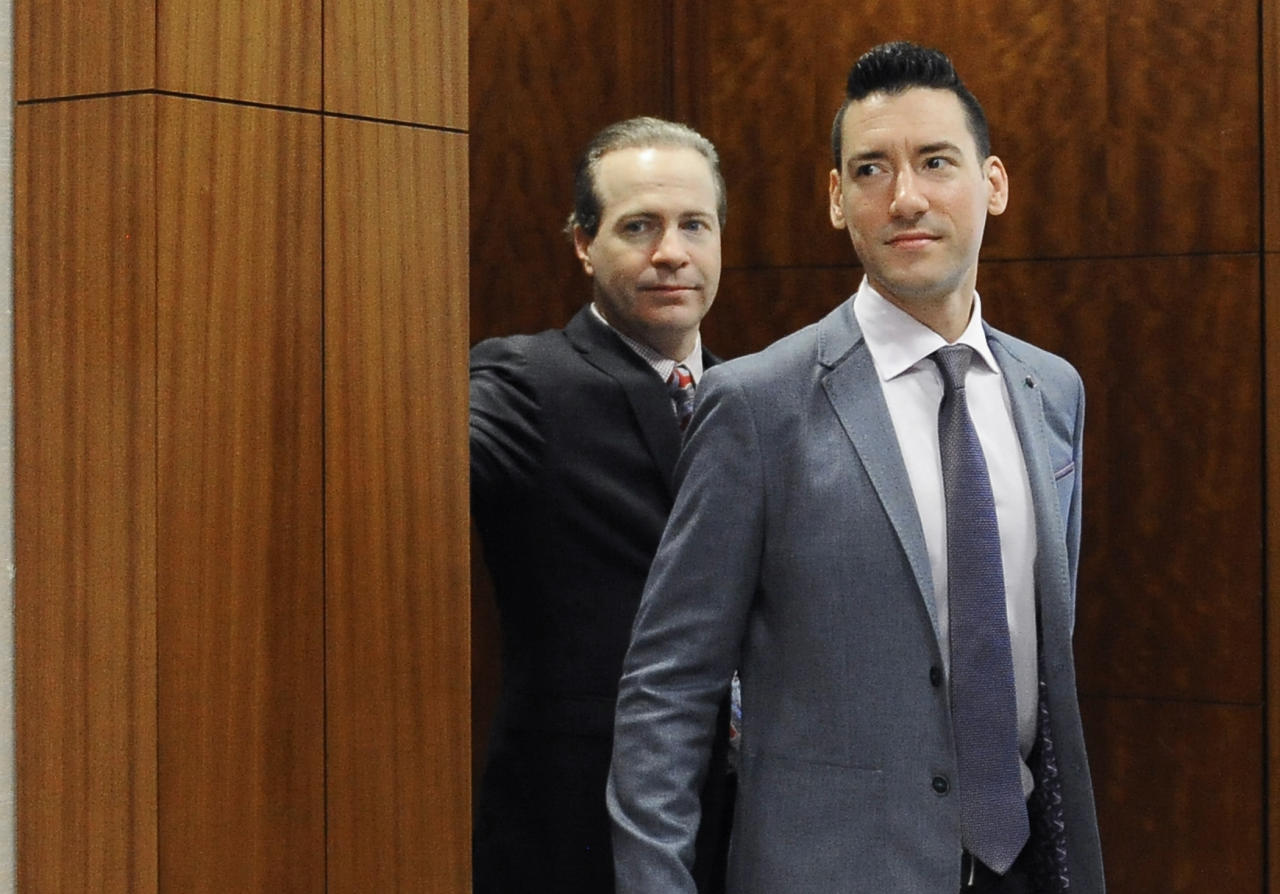 "FILE - In this April 29, 2016, file photo, David Robert Daleiden, right, with attorney Jared Woodfill leave a courtroom after a hearing in Houston. A federal judge deciding whether a fellow judge should disqualify himself from a lawsuit over an anti-abortion group's videos says he could not readily discern any appearance of bias. U.S. District Court Judge James Donato said Thursday, June 22, 2017, he was having trouble understanding how Judge William Orrick's affiliation with a non-profit and two Facebook ""likes"" by Orrick's wife created an appearance of bias against defendant David Daleiden. (AP Photo/Pat Sullivan, File)"