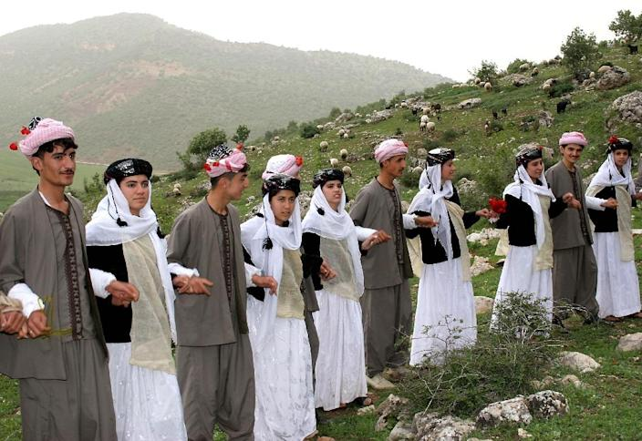 Yazidis, a religious minority centered in the Iraqi Kurdistan region, wear traditional clothes during the celebration of their New Year, near Dohuk (AFP Photo/Safin Hamed)