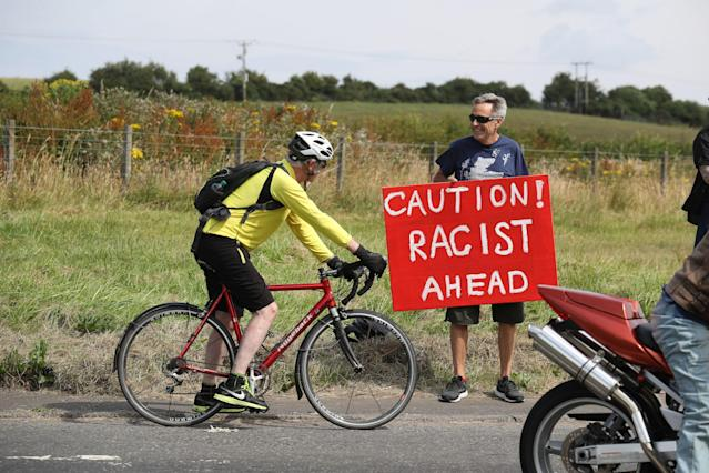 <p>A protester rides his bike near Turnberry, where President Trump and first lady Melania Trump are spending the weekend at the Trump Turnberry resort in South Ayrshire, Scotland. (Photo: Andrew Milligan/PA Images via Getty Images) </p>
