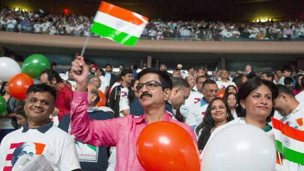 Audience members wave Indian flags and hold balloons during an event with India's Prime Minister Modi at Madison Square Garden in New York