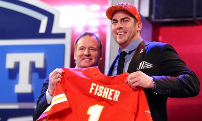 Eric Fisher stands on stage with NFL Commissioner Roger Goodell after Fisher was picked #1 overall by the Kansas City Chiefs.