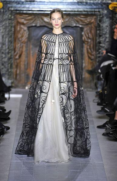 <b>Valentino SS13 </b><br><br>Full-length, nude dresses featured a black patterned overlay that fell to the floor.<br><br>© Rex