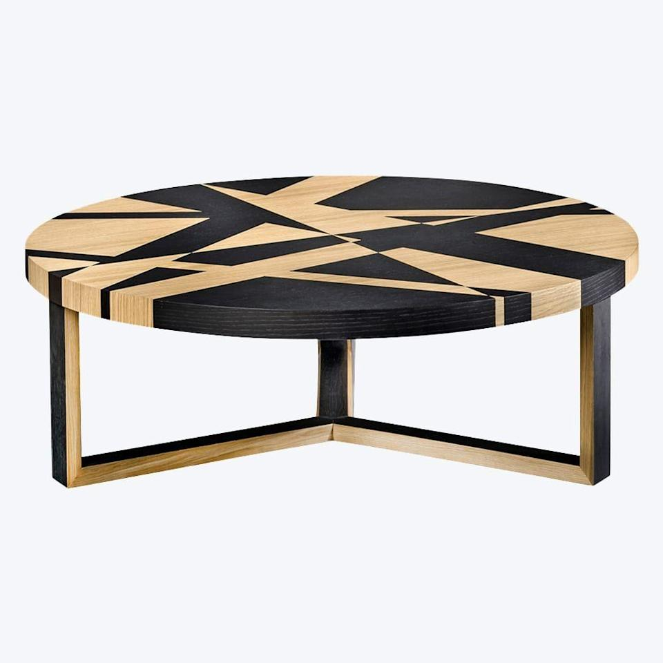 """<p><strong>Pinto Paris</strong></p><p>theinvisiblecollection.com</p><p><a href=""""https://theinvisiblecollection.com/product/pinto-paris-achille-coffee-table/"""" rel=""""nofollow noopener"""" target=""""_blank"""" data-ylk=""""slk:Shop Now"""" class=""""link rapid-noclick-resp"""">Shop Now</a></p><p>This tinted oak table is the ultimate statement piece for any living room.</p>"""