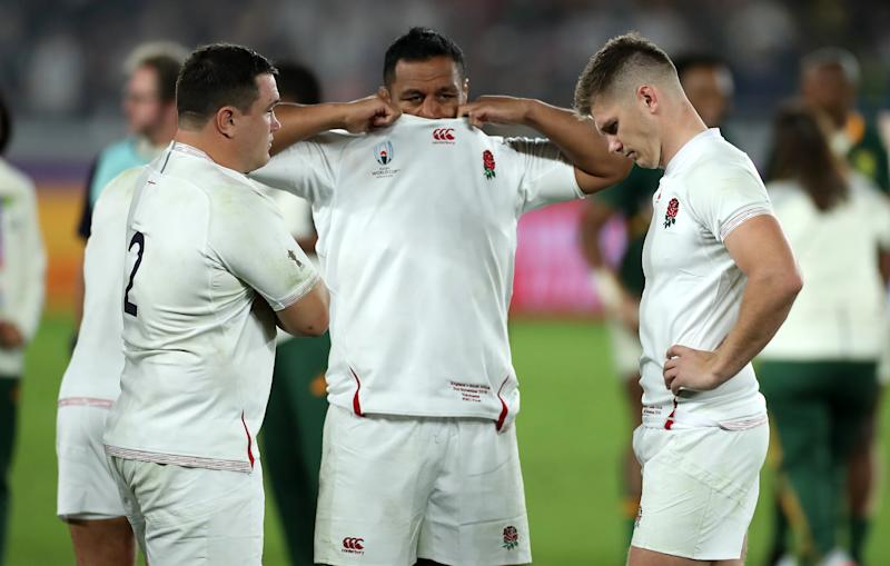 YOKOHAMA, JAPAN - NOVEMBER 02: Owen Farrell, (R) the England captain looks dejected with team mates Jamie George (L) and Mako Vunipola after their defeat during the Rugby World Cup 2019 Final between England and South Africa at International Stadium Yokohama on November 02, 2019 in Yokohama, Kanagawa, Japan. (Photo by David Rogers/Getty Images)