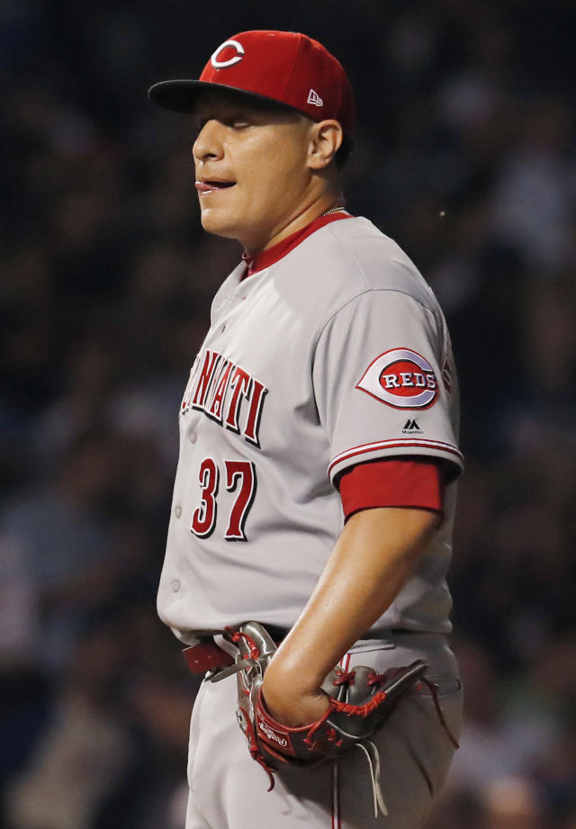 Cincinnati Reds' David Hernandez reacts after giving up a a three-run home run to Chicago Cubs' Ian Happ during the seventh inning of a baseball game Friday, Sept. 14, 2018, in Chicago. (AP Photo/Jim Young)