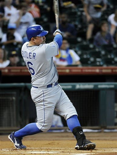 Kansas City Royals' Billy Butler watches the ball go over the wall for a solo home run against the Houston Astros in the first inning of a baseball game, Tuesday, June 19, 2012, in Houston. (AP Photo/Pat Sullivan)