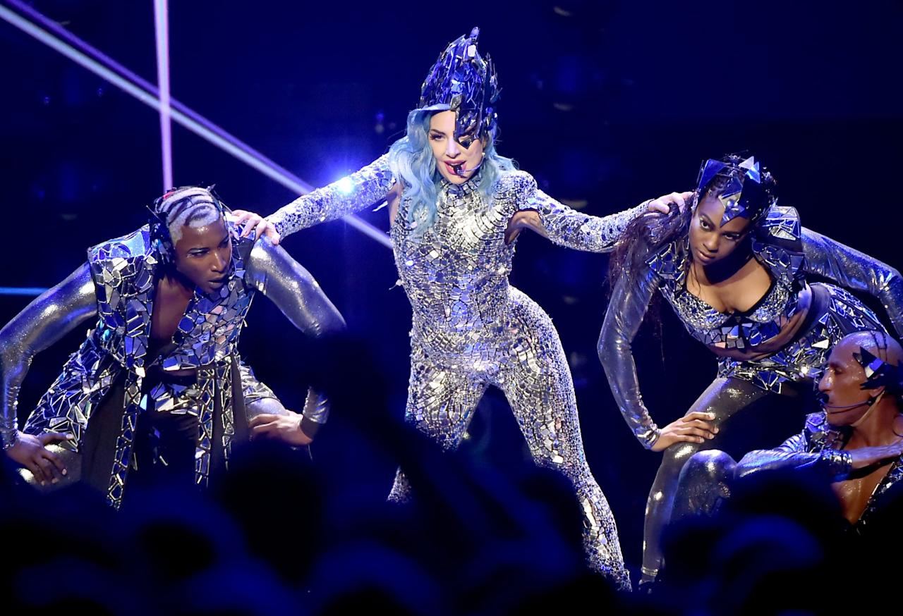 """<p>In addition to leading the pack of nominees with a total of nine nods, <a class=""""sugar-inline-link ga-track"""" title=""""Latest photos and news for Lady Gaga"""" href=""""https://www.popsugar.com/Lady-Gaga"""" target=""""_blank"""" data-ga-category=""""Related"""" data-ga-label=""""https://www.popsugar.com/Lady-Gaga"""" data-ga-action=""""&lt;-related-&gt; Links"""">Lady Gaga</a> will be hitting the MTV VMAs stage for a special performance. </p>"""