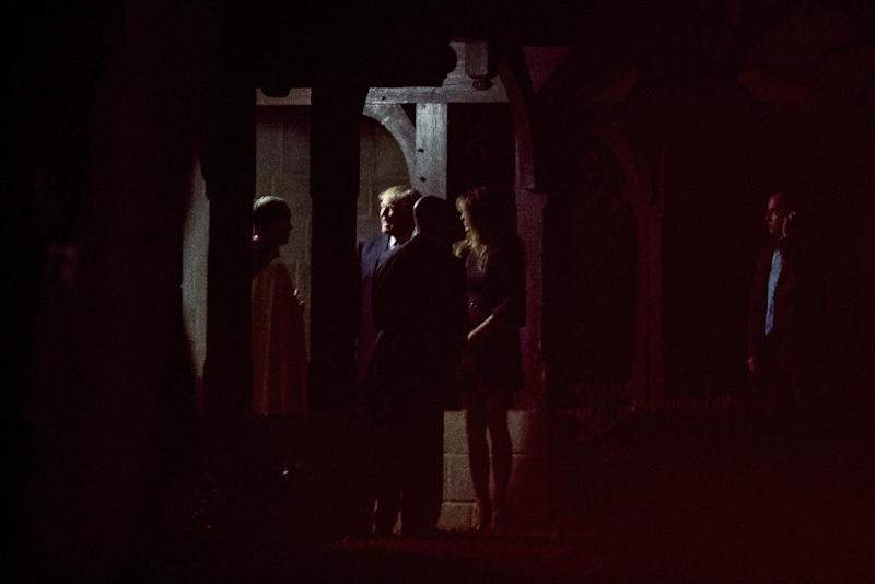 President-elect Donald Trump, second from left, accompanied by his wife, Melania Trump, center right, departs after attending a Christmas Eve service at the Church of Bethesda-by-the Sea, in West Palm Beach, Fla., Saturday, Dec. 24, 2016. (AP Photo/Andrew Harnik)