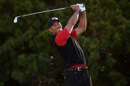FILE PHOTO: Jan 28, 2018; San Diego, CA, USA; Tiger Woods plays his shot from the 11th tee during the final round of the Farmers Insurance Open golf tournament at Torrey Pines Municipal Golf Course - South Co. Mandatory Credit: Orlando Ramirez-USA TODAY Sports