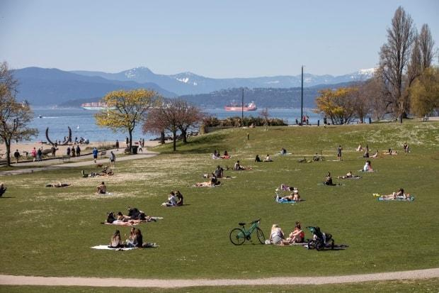 People soak up the sun on Sunset Beach in Vancouver in April.  (Ben Nelms/CBC - image credit)