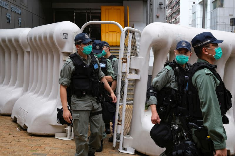 Riot police are seen during a march against new security laws, near China's Liaison Office, in Hong Kong